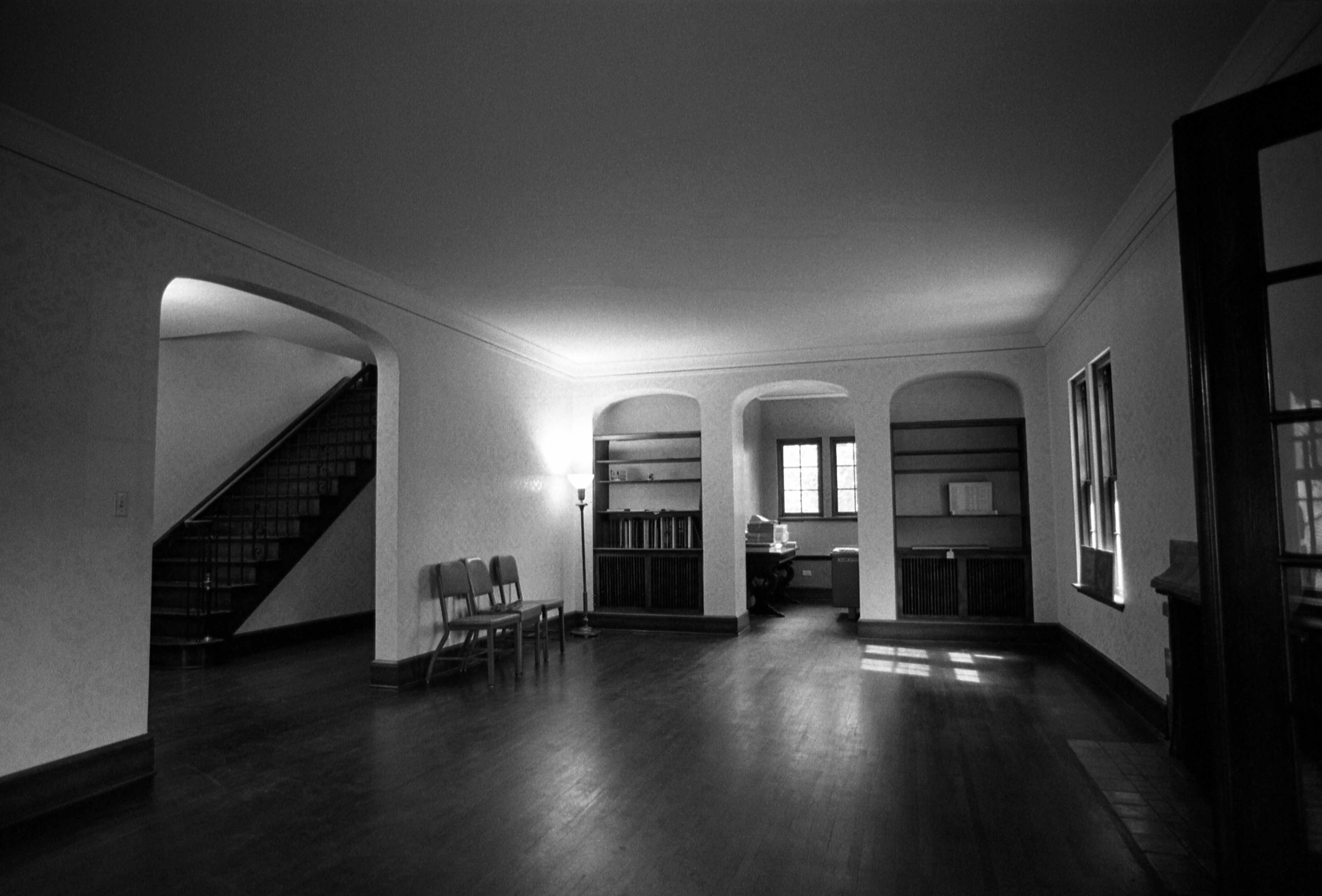 Lewis House first floor living room, foyer, and steps, 1973