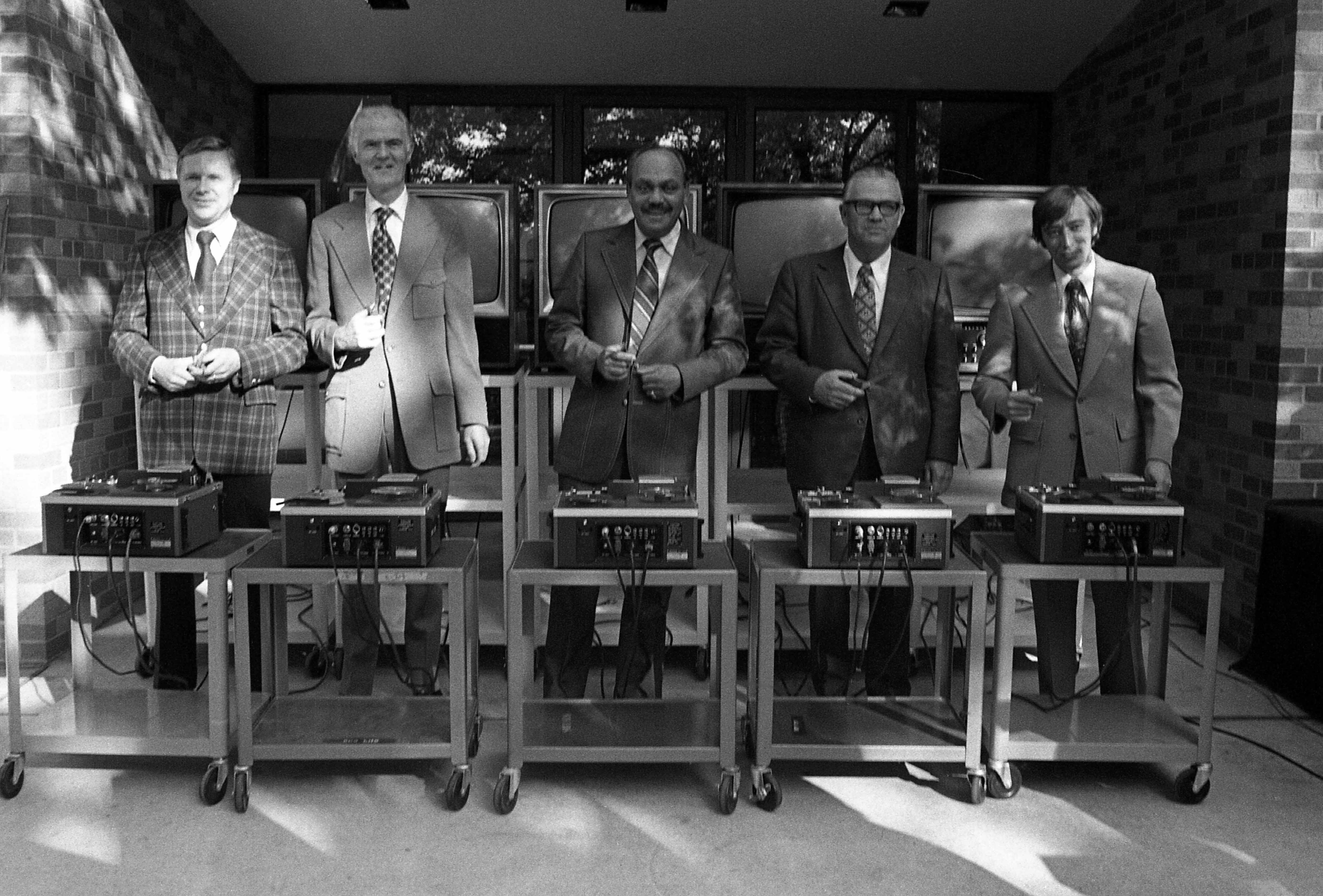Participants get ready to cut the electronic ribbon at Kiehle rededication, September 1975