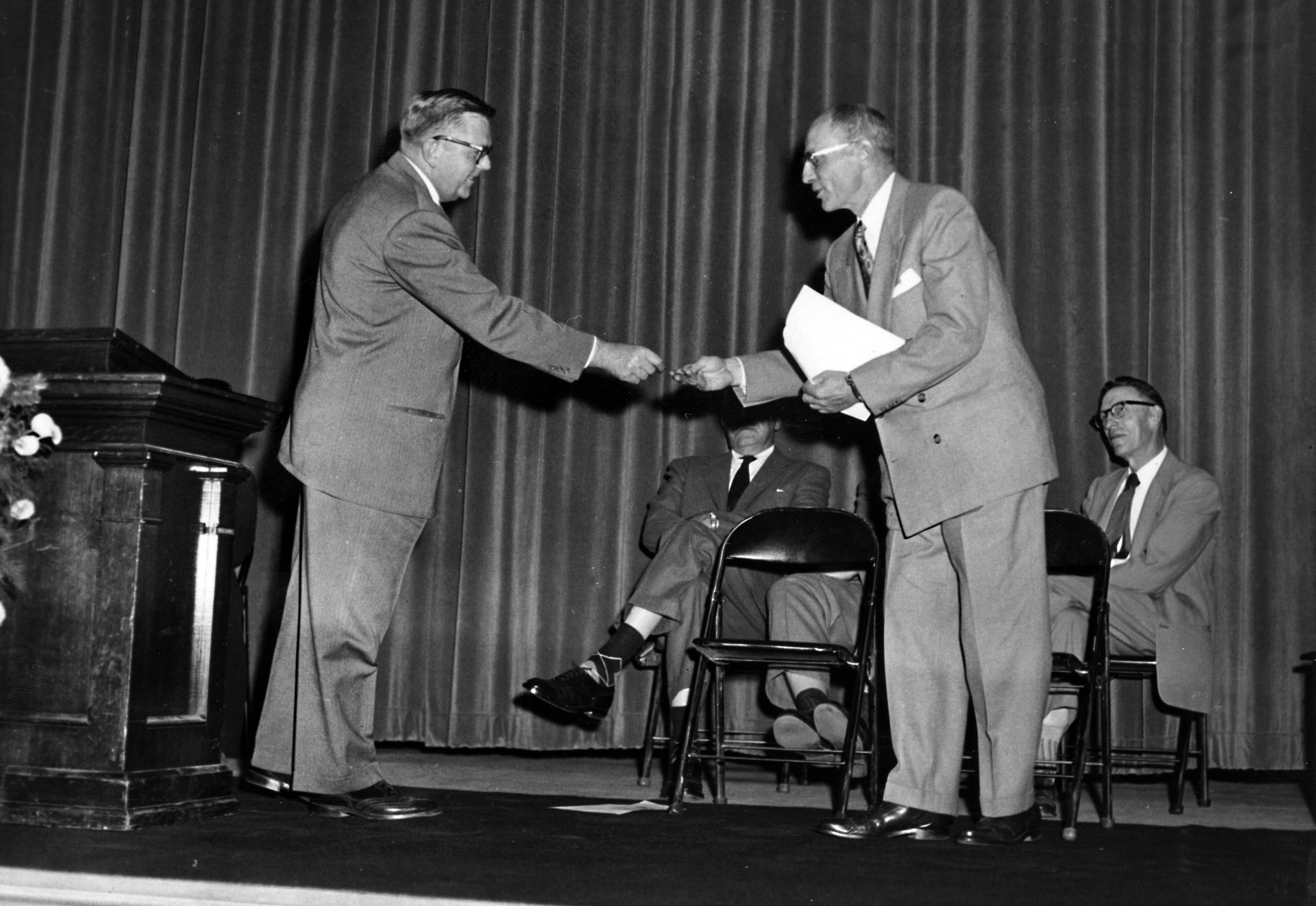 Wilbur Holes (right) accepts the keys to Kiehle, 1953