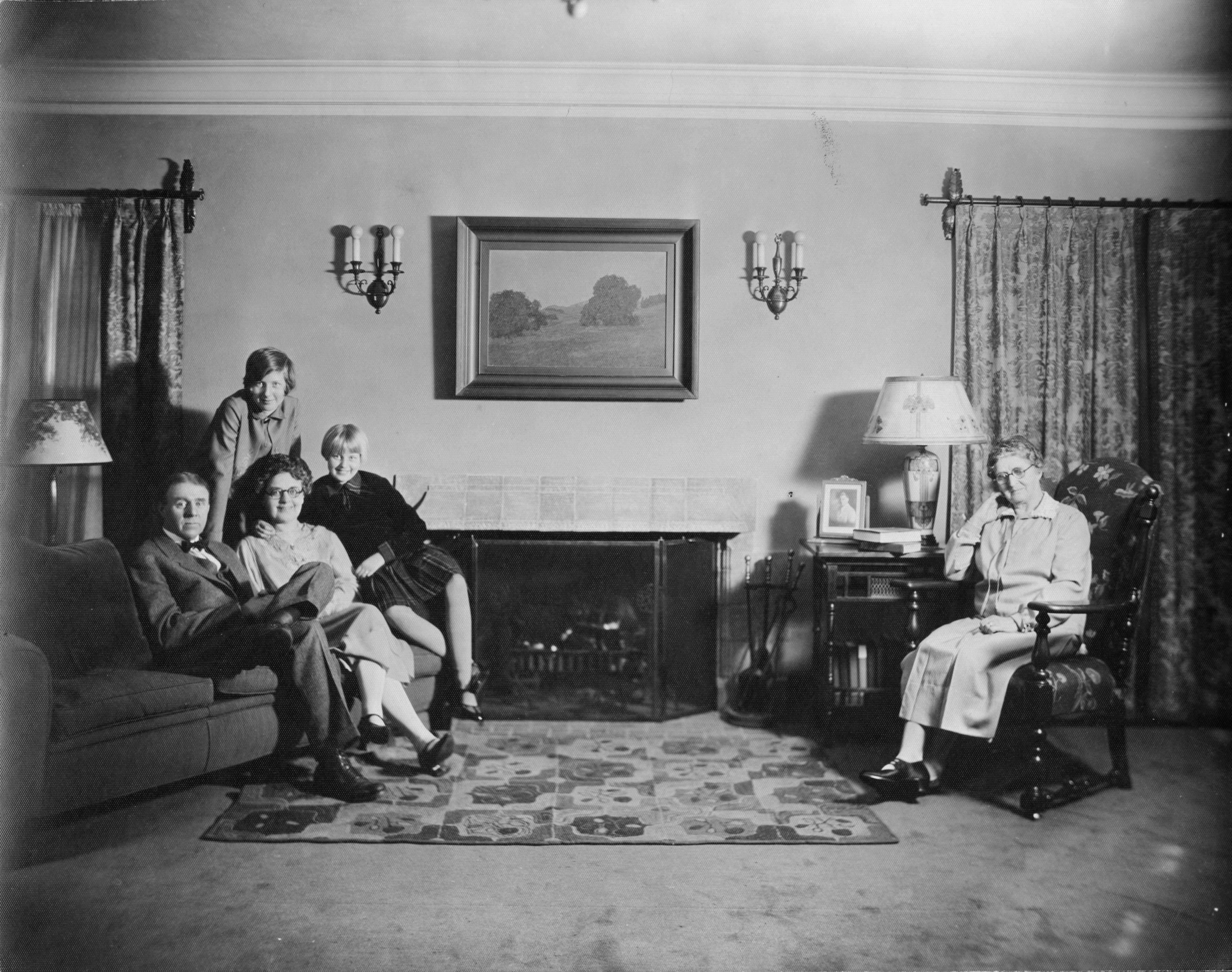 Claude Lewis family in living room, 1930s
